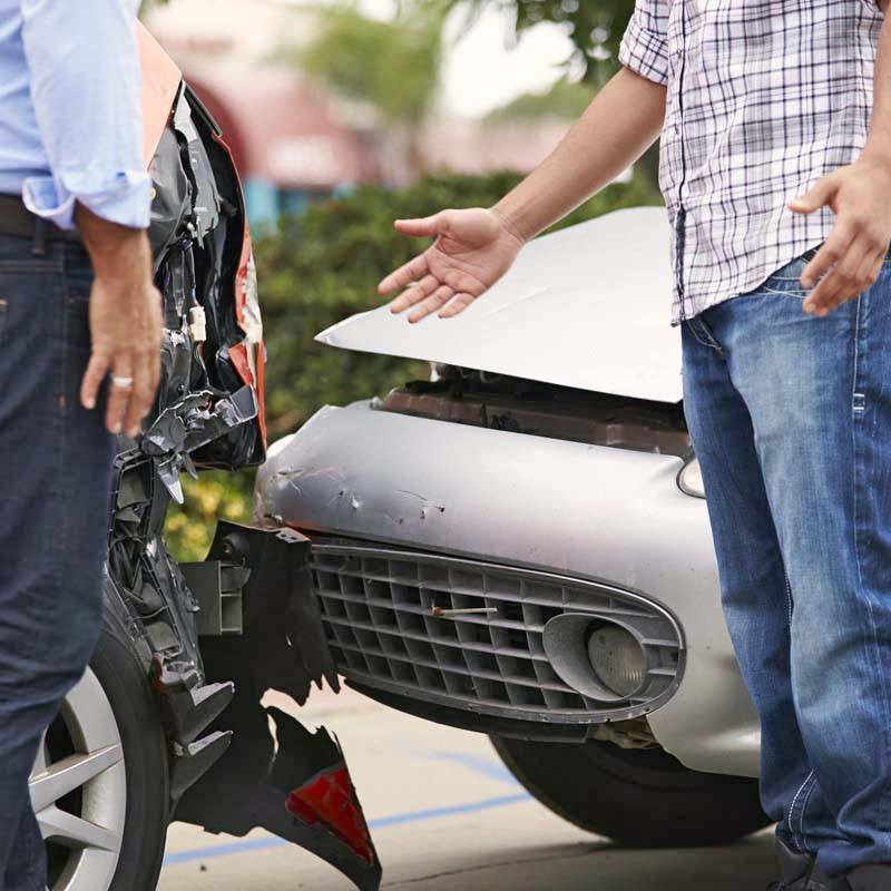 Drivers in an AZ car accident talking avoid admitting fault